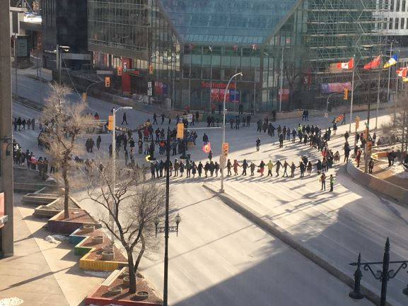 protesters participating in a round dance at Winnipeg's Portage and Main intersection